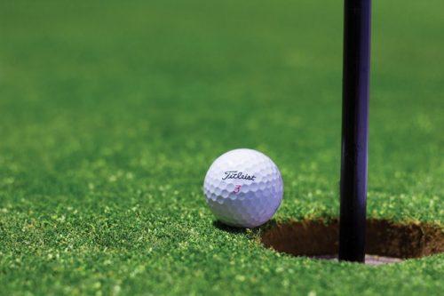 golf ball near hole © pexels.com